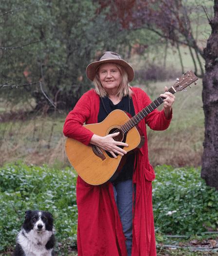 Poet and songwriter Sara Hoxie and her wonderdog Niki
